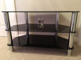 Black glass and chrome 3 tier TV unit in very good condition.