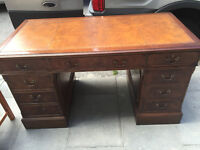 Mahogany Twin Pedestal Desk , with brown leather top . Drawers at both sides.