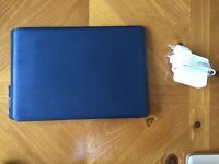 Apple MacBook Pro 7,1 (13-inch Mid 2010) A1278 with software package, charger, and protective cover