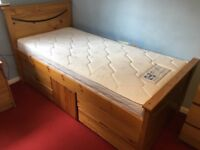 Single wooden storage bed with cupboard and 4 drawers in good condition