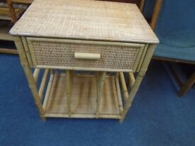 small bamboo and wicker table with drawer.