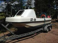 Dory fishing boat and double axel trailer.