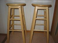 Pair of Wooden Bar Stools. 74cm high and in good condition.
