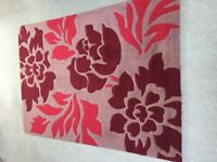 Brown, red and burgundy floral rug