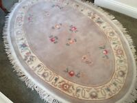 Beautiful, large, oval shape Chinese style thick pile rug in soft pastel colours