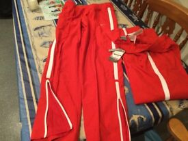 NIKE 'joggers' BRAND NEW WITH TAGS size med 10/12 ish. Ankle zip & 2 front/rear pockets. BARGAIN.