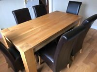 Solid oak dining room table with 6 leather chairs