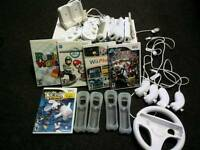 WII for sale with games and several accessories