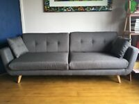 Three seater grey sofa - like new . Barely sat on - in great condition