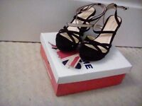 Women's, size6 UK, 39 EU, black suede, strappy wedge-heeled dress shoe.