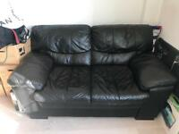 DFS Black leather two seater sofa