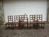 Dining Chairs, Solid oak. Leather drop in seats. Set of 6 plus carver. Circa 1930