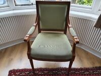Vintage armchair with green velour upholstery