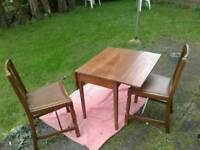 19th century mahogany pembroke table with two 1950's oak dining chairs