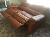 Reclining leather sofa and two chairs