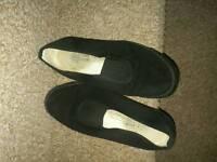 Well worn ladies plimsoles/sandshoes