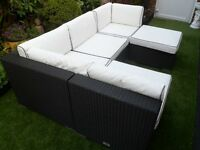 Stylish, Black weaved frame and white cushions with black pipped edgeing