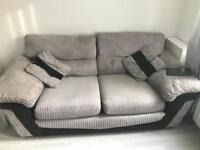 Grey fabric sofa 3 seater and 2 seater sofa bed.