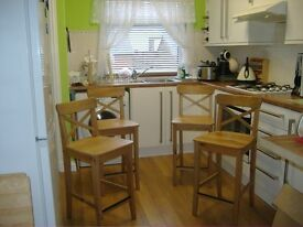 four bar/breakfast wooden chairs in excellent conditionbought from argos four weeks ago