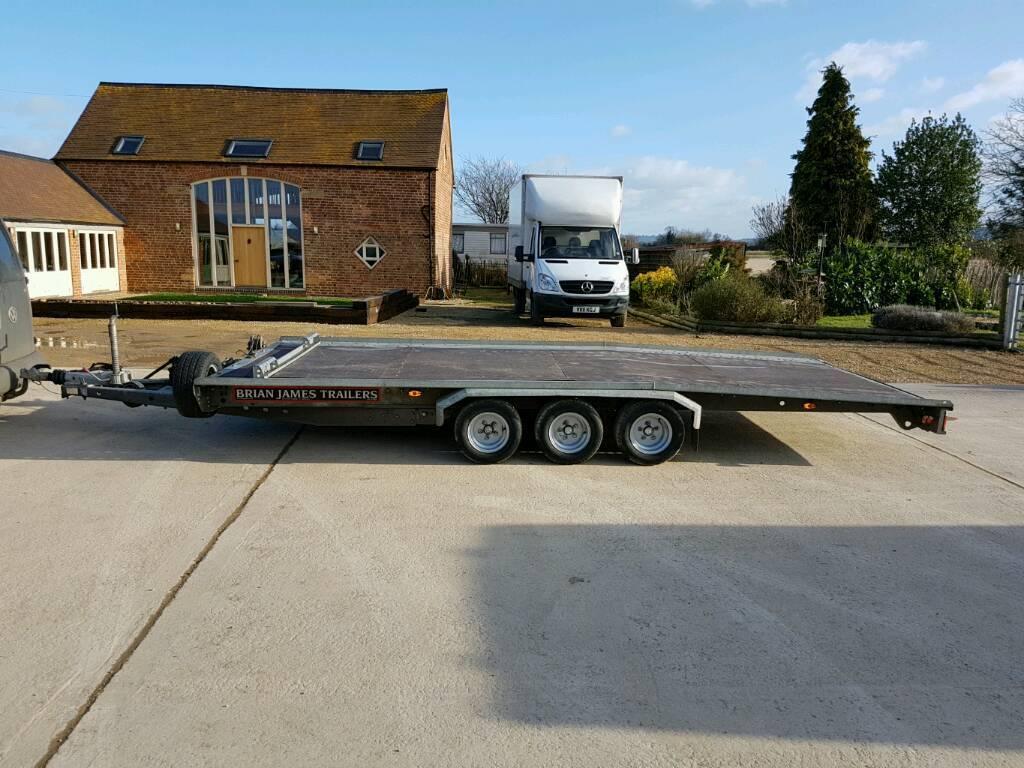 Bryan james tripple axle tilt bed trailer. NO VAT
