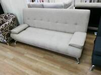 Cream fabric sofabed with metal legs folds up and down