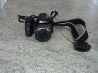 Fuji Finepix S8200 digital camera, very little use from new. Carry bag in new condition.