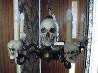 pair of bronze skull mounted chandeliers,