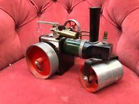 Steam roller. Steam powered.
