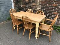Lovely farmhouse table and six chairs.