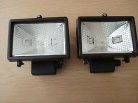 TWO FLOODLIGHTS, WITH 150 WATT HALOGEN BULBS, AND MOUNTING BRACKET, 220-240 VOLT, IP44 PROTECTION.