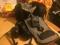 Nikon d3200 DSLR 18-55mm lens AF lens, strap and backpack