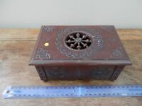 A small carved wooden box