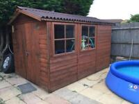 Garden shed , solid , hard roof panels, 3mX2m , double doors, two openable windows .