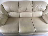 Cream leather 3 seater sofa a reclining arm chair.