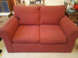 Still available - Red 2 seater sofa