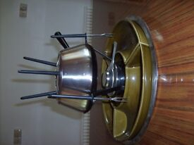 Fondue set with 6 forks, side dishes, mentholated spirit warmer, instruction and tray.
