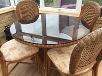 Cane table & 4 chairs