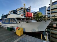 Unique big houseboat on residential mooring in Canary Wharf