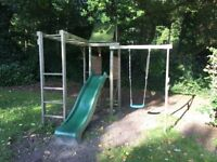 Children's climbing frame with swing and slide
