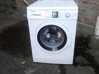 Bosch 9kg washing machine , refurbished , with warranty .