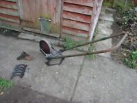 A VINTAGE HAND PUSH GARDEN CULTIVATOR, WITH TOOLS.