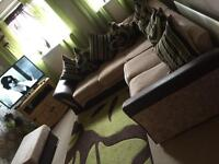 Corner sofa with armchair and foot stall with storage.