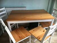 Lovely wooden table with 4 chairs