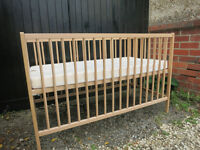 wooden cot with mattress