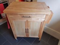 Beautiful wooden kitchen trolley with built in knife rack and underslung storage. Bargain at 40GBP!