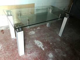 Glass dining table with frosted glass under shelf