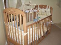 Wooden drop side cot and mattress