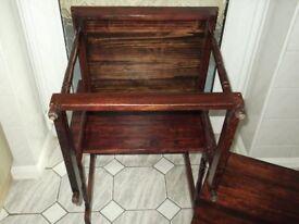 Nest of three solid dark wood tables