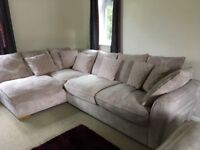 Corner sofa with additional cushions and puffet