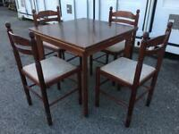 Extending dining table and four chairs. Can deliver locally for £5